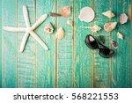 Seashells On Green Wooden Plan...