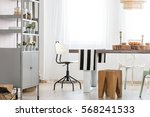 table and chairs in bright... | Shutterstock . vector #568241533