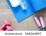 flat lay of red dumbbells and... | Shutterstock . vector #568264897