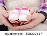 pink booties for newborn baby... | Shutterstock . vector #568331617