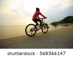 one young woman riding bike on... | Shutterstock . vector #568366147