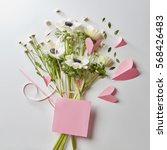 bouquet of flowers and hearts | Shutterstock . vector #568426483
