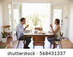 couple enjoying meal at home... | Shutterstock . vector #568431337