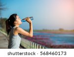 beautiful woman drinks water... | Shutterstock . vector #568460173