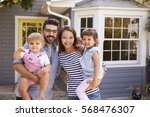 portrait of excited family... | Shutterstock . vector #568476307
