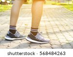 sporty man running on road at