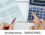 accountant verify the saving... | Shutterstock . vector #568502983