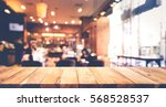 wood table top with blur of... | Shutterstock . vector #568528537