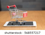 tablet and shopping cart on... | Shutterstock . vector #568557217