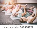 instructor performing yoga with ... | Shutterstock . vector #568580197