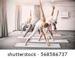 instructor performing yoga with ... | Shutterstock . vector #568586737