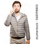 confident man keeping a secret | Shutterstock . vector #568598803