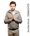 photo of a hopeful man praying | Shutterstock . vector #568601473