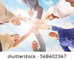 group of people showing unity... | Shutterstock . vector #568602367
