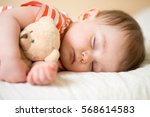 sleeping newborn baby on with a ... | Shutterstock . vector #568614583
