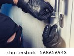 burglar with lock picking tools ... | Shutterstock . vector #568656943