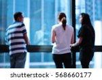 blur three people talking  | Shutterstock . vector #568660177