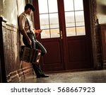 young vintage musician vagabond ... | Shutterstock . vector #568667923