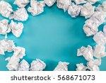 Crumpled Paper Balls On A Blue...