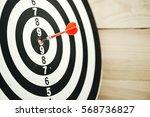 dart arrow hitting in the... | Shutterstock . vector #568736827