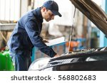 portrait of a mechanic at work... | Shutterstock . vector #568802683