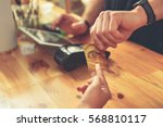 barista making payment for... | Shutterstock . vector #568810117