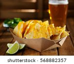 nachos and cheese in tray with... | Shutterstock . vector #568882357