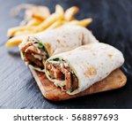 greek gyro wrap cut in half and ... | Shutterstock . vector #568897693