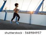 young woman runner running... | Shutterstock . vector #568984957