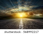 asphalt road between fields ... | Shutterstock . vector #568992217