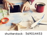 young man planning travel... | Shutterstock . vector #569014453