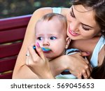baby feeding spoon by mother in ... | Shutterstock . vector #569045653