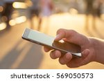 man using his mobile phone... | Shutterstock . vector #569050573