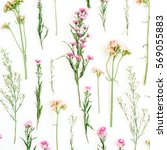 Stock photo floral pattern with pink and beige wildflowers green leaves branches on white background flat 569055883