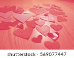 Many Hearts On Wooden Table....