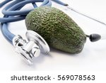 green avocado raw fruit lies... | Shutterstock . vector #569078563