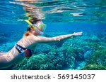 young woman swimming above the...   Shutterstock . vector #569145037