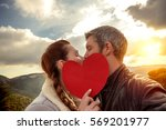 romantic couple on mountains... | Shutterstock . vector #569201977