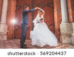 a beautiful bride and handsome... | Shutterstock . vector #569204437
