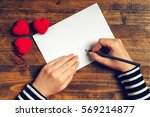 woman writing love letter or... | Shutterstock . vector #569214877