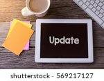 tablet pc with update and a cup ... | Shutterstock . vector #569217127