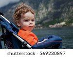 little curly haired boy sitting ... | Shutterstock . vector #569230897