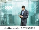 business man with tablet... | Shutterstock . vector #569251093