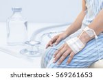 patient is on drip receiving a... | Shutterstock . vector #569261653