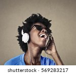 black girl listening to music... | Shutterstock . vector #569283217
