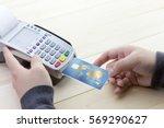 cashier hand holding a credit... | Shutterstock . vector #569290627