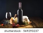 red wine in vintage light with... | Shutterstock . vector #569293237