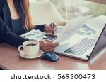 close up of woman hands using... | Shutterstock . vector #569300473