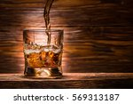 whiskey with ice on a wooden...   Shutterstock . vector #569313187