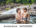 geothermal spa. father and son... | Shutterstock . vector #569330083